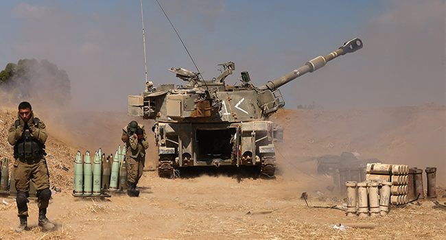 Israeli soldiers fire a 155mm self-propelled howitzer towards the Gaza Strip from their position near the southern Israeli city of Sderot on May 13, 2021. Menahem KAHANA / AFP