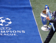 The trophy is carried pitch side ahead of the UEFA Champions League final football match between Manchester City and Chelsea at the Dragao stadium in Porto on May 29, 2021. SUSANA VERA / POOL / AFP