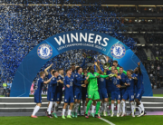 Chelsea's players celebrate with the trophy after winning the UEFA Champions League final football match at the Dragao stadium in Porto on May 29, 2021. PIERRE-PHILIPPE MARCOU / POOL / AFP