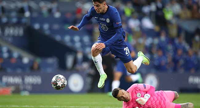 helsea's German midfielder Kai Havertz (L) scores a goal past Manchester City's Brazilian goalkeeper Ederson during the UEFA Champions League final football match between Manchester City and Chelsea FC at the Dragao stadium in Porto on May 29, 2021. Jose Coelho / POOL / AFP