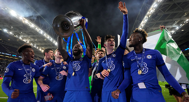 Chelsea's German defender Antonio Ruediger lifts the Champions League trophy during the UEFA Champions League final football match between Manchester City and Chelsea at the Dragao stadium in Porto on May 29, 2021. Manu Fernandez / POOL / AFP