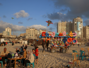Palestinians gather at the beach in Gaza city on May 22, 2021, following a ceasefire that ended 11 days of relentless Israeli air strikes on the besieged coastal enclave run by the Hamas group. MAHMUD HAMS / AFP