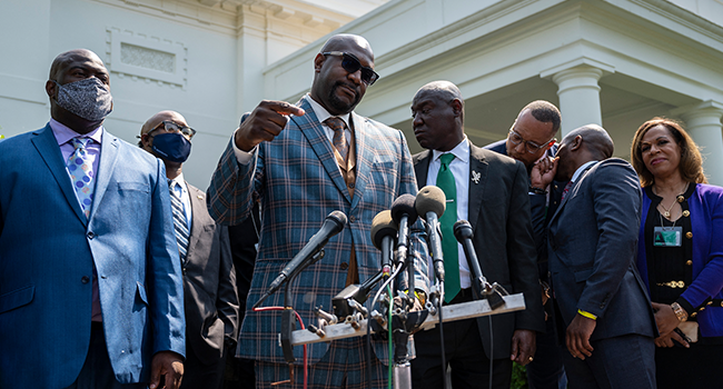 George Floyd's brother Philonise Floyd speaks with other family members and lawyers outside the White House after meeting with US President Joe Biden in Washington, DC, on May 25, 2021. JIM WATSON / AFP