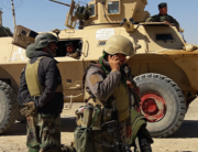 Afghan security forces stand near an armoured vehicle during ongoing fighting between Afghan security forces and Taliban fighters in the Busharan area on the outskirts of Lashkar Gah, the capital city of Helmand province May 5, 2021. Sifatullah ZAHIDI / AFP