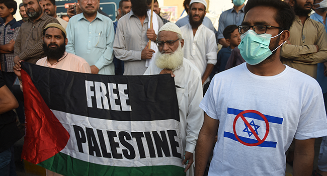 Supporters of Islamic political party Jamaat-e-Islami (JI) gather during a demonstration in Karachi on May 11, 2021, to protest against Israel's deadly air strikes launched on Gaza killing at least 28 people. Rizwan TABASSUM / AFP