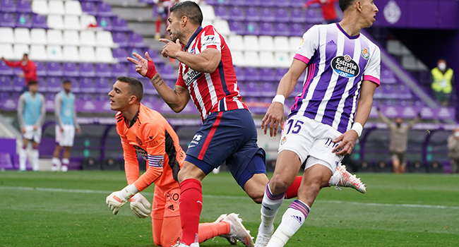 Atletico Madrid's Uruguayan forward Luis Suarez (C) celebrates after scoring during the Spanish league football match Real Valladolid FC against Club Atletico de Madrid at the Jose Zorilla stadium in Valladolid on May 22, 2021. CESAR MANSO / AFP