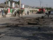 Security personnel stand at the site of an explosion in Kabul on June 3, 2021, after at least four people were killed and four others injured when a minibus was hit by an explosion in Kabul, according to police, in the latest attack on commuters in the Afghan capital. Zakeria HASHIMI / AFP