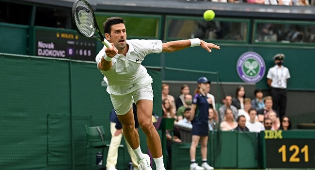 Djokovic Slides To Victory As Wimbledon Makes Soggy Return