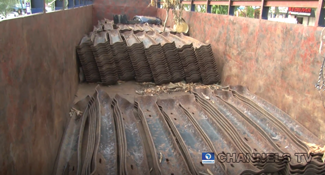 Vandalised rail tracks materials are loaded on trucks for transport in Nasarawa.