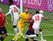 England's forward Raheem Sterling (R) scores the opening goal during the UEFA EURO 2020 Group D football match between Czech Republic and England at Wembley Stadium in London on June 22, 2021. NEIL HALL / POOL / AFP
