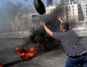 Demonstrators burn tires to block the Martyrs' Square in the centre of Lebanon's capital Beirut on June 26, 2021, as they protest against dire living conditions amidst the ongoing economical and political crisis. ANWAR AMRO / AFP