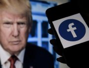 In this file photo illustration taken on May 04, 2021, a phone screen displays a Facebook logo with the official portrait of former US President Donald Trump on the background in Arlington, Virginia. Olivier DOULIERY / AFP