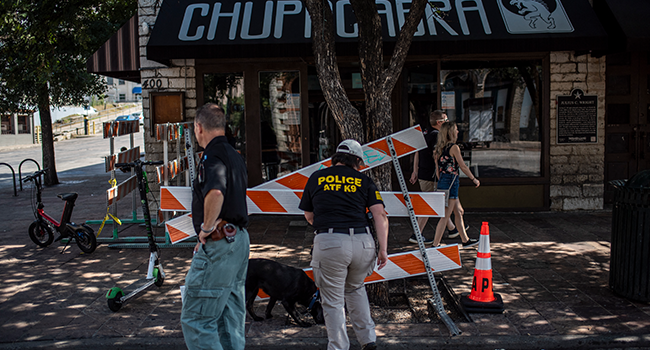 An ATF K9 unit surveys the area near the scene of a shooting on June 12, 2021 in Austin, Texas. Sergio Flores/Getty Images/AFP