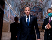 US Secretary of State Antony Blinken (C) and Charge d'Affaires of the US Embassy to the Holy See Patrick Connell (L) and tour guide Alessandro Conforti (R), leave the Sistine Chapel, in the Apostolic Palace, at the Vatican, ahead of a meeting with Pope Francis and Archbishop Paul Gallagher, as part of a three-nation tour of Europe, on June 28, 2021. Andrew Harnik / POOL / AFP
