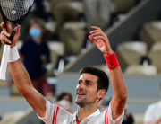 Serbia's Novak Djokovic celebrates after winning against Spain's Rafael Nadal at the end of their men's singles semi-final tennis match on Day 13 of The Roland Garros 2021 French Open tennis tournament in Paris on June 11, 2021. MARTIN BUREAU / AFP