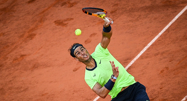 Spain's Rafael Nadal serves the ball to Serbia's Novak Djokovic during their men's singles semi-final tennis match on Day 13 of The Roland Garros 2021 French Open tennis tournament in Paris on June 11, 2021. Anne-Christine POUJOULAT / AFP