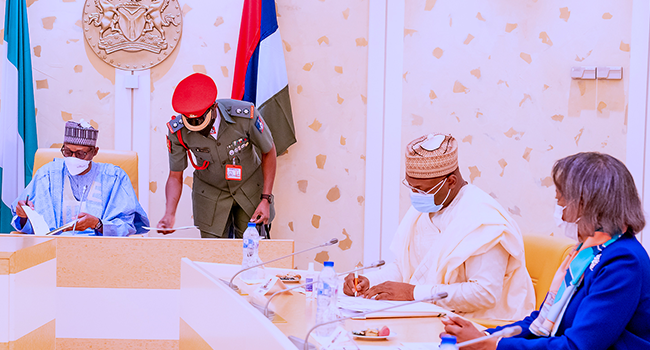 President Buhari receives a briefing from Chairman and Members of the Independent National Electoral Commission (INEC) in State House on June 1, 2021. Bayo Omoboriowo/State House