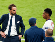 England's coach Gareth Southgate (L) speaks with England's forward Marcus Rashford (R) ahead of going on during the UEFA EURO 2020 final football match between Italy and England at the Wembley Stadium in London on July 11, 2021. JOHN SIBLEY / POOL / AFP
