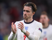 England's midfielder Jack Grealish greets the fans after their loss in the UEFA EURO 2020 final football match between Italy and England at the Wembley Stadium in London on July 11, 2021. Laurence Griffiths / POOL / AFP