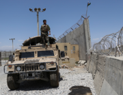 An Afghan National Army (ANA) soldier looks out while standing on a Humvee vehicle at Bagram Air Base, after all US and NATO troops left, some 70 Km north of Kabul on July 2, 2021. Zakeria HASHIMI / AFP
