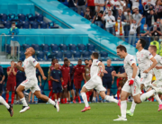 Spain's players celebrate after winning during the UEFA EURO 2020 quarter-final football match between Switzerland and Spain at the Saint Petersburg Stadium in Saint Petersburg on July 2, 2021. MAXIM SHEMETOV / POOL / AFP