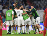 Italy players celebrate victory as Belgium players react at the end of the UEFA EURO 2020 quarter-final football match between Belgium and Italy at the Allianz Arena in Munich on July 2, 2021. ANDREAS GEBERT / POOL / AFP