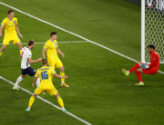 England's forward Harry Kane (09) scores the team's first goal during the UEFA EURO 2020 quarter-final football match between Ukraine and England at the Olympic Stadium in Rome on July 3, 2021. ALESSANDRO GAROFALO / POOL / AFP
