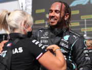 Race winner Mercedes' British driver Lewis Hamilton celebrates after the Formula One British Grand Prix motor race at Silverstone motor racing circuit in Silverstone, central England on July 18, 2021. LARS BARON / POOL / AFP