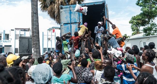Desperate Haitians Rush Aid Convoys After Quake