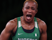 Nigeria's Blessing Oborududu reacts after winning against Mongolia's Battsetseg Soronzonbold in their women's freestyle 68kg wrestling semi-final match during the Tokyo 2020 Olympic Games at the Makuhari Messe in Tokyo on August 2, 2021. Jack GUEZ / AFP