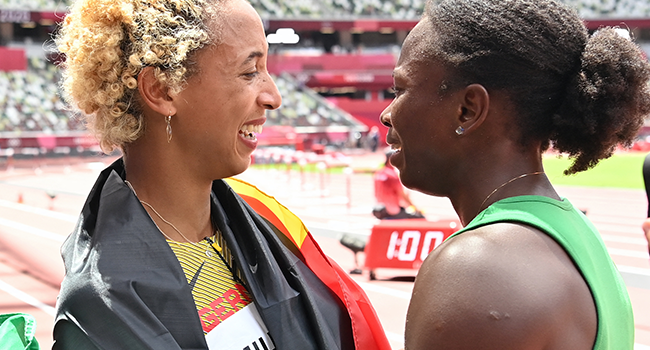 First-plcaed Germany's Malaika Mihambo (L) celebrates with third-placed Nigeria's Ese Brume after competing in the women's long jump final during the Tokyo 2020 Olympic Games at the Olympic Stadium in Tokyo on August 3, 2021. Andrej ISAKOVIC / AFP