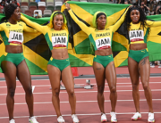 First-placed (from L) Jamaica's teammates Shericka Jackson, Briana Williams, Shelly-Ann Fraser-Pryce and Elaine Thompson-Herah celebrate after wining the women's 4x100m relay final during the Tokyo 2020 Olympic Games at the Olympic Stadium in Tokyo on August 6, 2021. Andrej ISAKOVIC / AFP