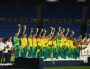 Brazil's gold medallists (C) celebrate on the podium during the medal ceremony of the Tokyo 2020 Olympic Games men's football competition at Yokohama International Stadium in Yokohama, Japan, on August 7, 2021. LOIC VENANCE / AFP