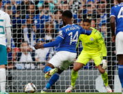Leicester City's Nigerian striker Kelechi Iheanacho (C) scores the opening goal from the penalty spot during the English FA Community Shield football match between Manchester City and Leicester City at Wembley Stadium in north London on August 7, 2021. Adrian DENNIS / AFP