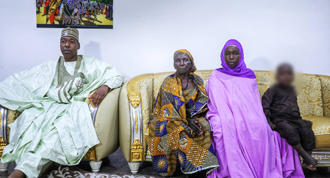 Ruth Ngladar Pogu (R) and her mother with Governor Babagana Zulum at the Borno State Government House on August 7, 2021.