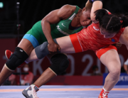Nigeria's Blessing Oborududu (blue) wrestles Mongolia's Battsetseg Soronzonbold in their women's freestyle 68kg wrestling semi-final match during the Tokyo 2020 Olympic Games at the Makuhari Messe in Tokyo on August 2, 2021. Jack GUEZ / AFP