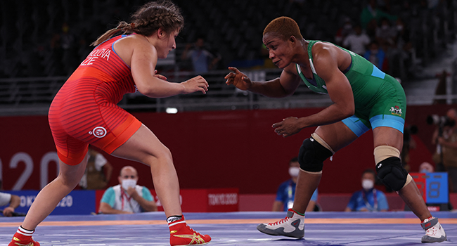 Nigeria's Blessing Oborududu (blue) wrestles Azerbaijan's Elis Manolova in their women's freestyle 68kg wrestling early round match during the Tokyo 2020 Olympic Games at the Makuhari Messe in Tokyo on August 2, 2021. Jack GUEZ / AFP