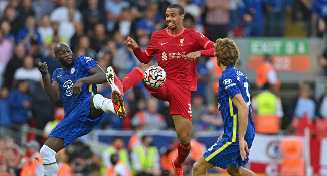 Liverpool's German-born Cameroonian defender Joel Matip (C) vies with Chelsea's Belgian striker Romelu Lukaku (L) and Chelsea's Spanish defender Marcos Alonso (R) during the English Premier League football match between Liverpool and Chelsea at Anfield in Liverpool, north west England on August 28, 2021. Paul ELLIS / AFP