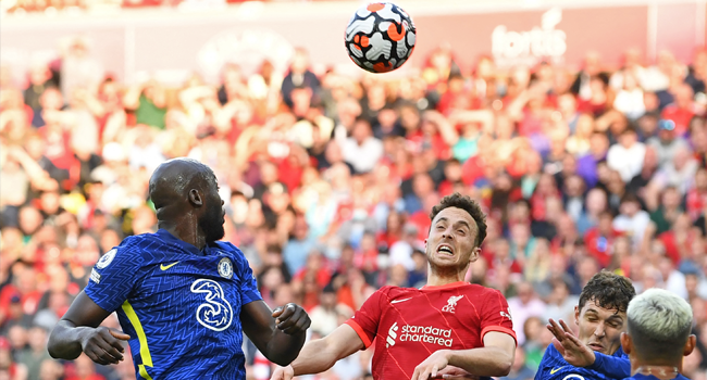Liverpool's Portuguese striker Diogo Jota (C) vies with Chelsea's Belgian striker Romelu Lukaku (L) and Chelsea's Danish defender Andreas Christensen (R) during the English Premier League football match between Liverpool and Chelsea at Anfield in Liverpool, north west England on August 28, 2021. Paul ELLIS / AFP