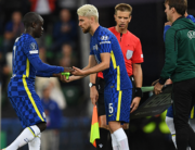 Chelsea's Italian midfielder Jorginho (C) replaces Chelsea's French midfielder N'Golo Kante (L) during the UEFA Super Cup football match between Chelsea and Villarreal at Windsor Park in Belfast on August 11, 2021. Paul ELLIS / AFP