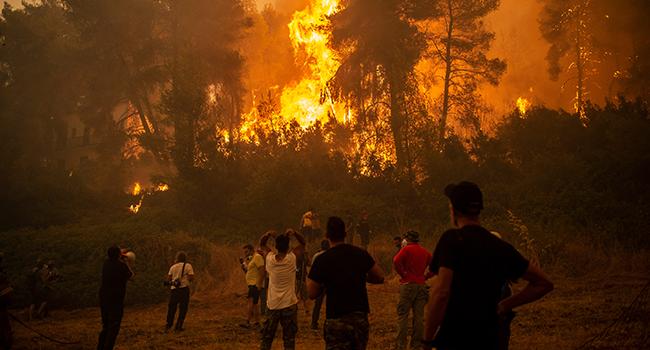 Greek Villagers Abandon Island Over Raging Fires