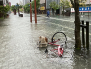 A flooded street is seen in Saga city on August 14, 2021, as torrential rain triggered floods and landslides in western Japan. STR / JIJI PRESS / AFP
