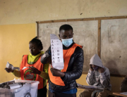 Officers from the Electoral Commission of Zambia (ECZ) count ballot papers at a polling station in Lusaka on August 13, 2021, following presidential and legislative elections seen as test of the country's democractic credentials after a tense campaign dominated by economic woes and a debt crisis. Patrick Meinhardt / AFP