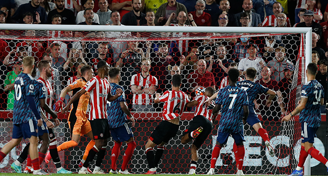 Brentford's Danish midfielder Christian Norgaard (C #6) scores their second goal during the English Premier League football match between Brentford and Arsenal at Brentford Community Stadium in London on August 13, 2021. Adrian DENNIS / AFP