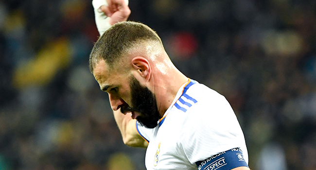Real Madrid's French forward Karim Benzema celebrates after Shakhtar Donetsk's Ukrainian defender Serhiy Kryvtsov scored an own goal during the UEFA Champions League football match between Shakhtar Donetsk and Real Madrid at the Olympic Stadium in Kiev on October 19, 2021. Sergei SUPINSKY / AFP