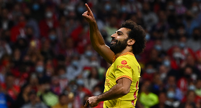 Liverpool's Egyptian forward Mohamed Salah celebrates after scoring his team's third goal during the UEFA Champions League Group B football match between Atletico Madrid and Liverpool at the Wanda Metropolitano stadium in Madrid on October 19, 2021. GABRIEL BOUYS / AFP
