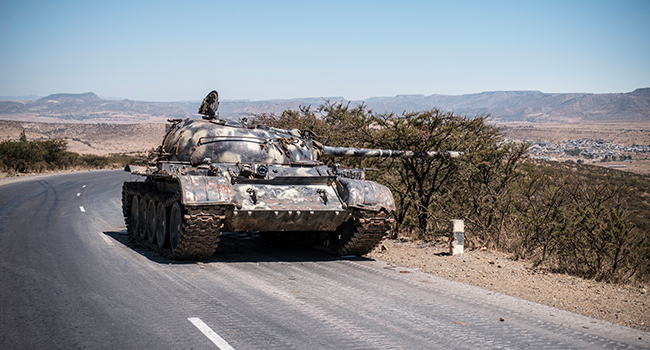 In this file photo taken on February 26, 2021 A damaged tank stands on a road north of Mekele, the capital of Tigray. EDUARDO SOTERAS / AFP