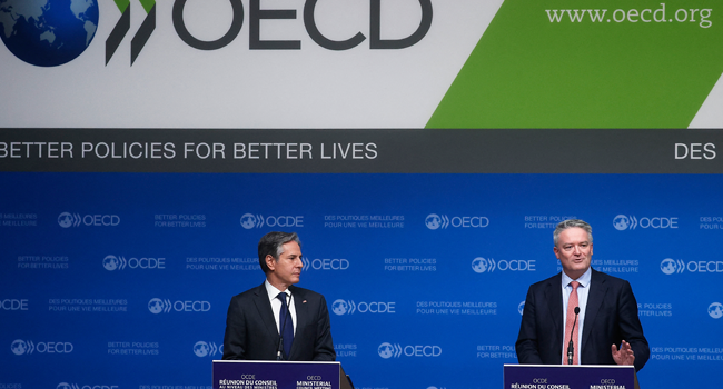Secretary-General of the Organization for Economic Cooperation and Development (OECD) Mathias Cormann (R) and US Secretary of State Anthony Blinken hold a closing press conference at the 60th OECD Ministerial Council Meeting on October 6, 2021, in Paris. Ian LANGSDON / POOL / AFP