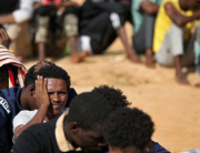 African migrants gather at a makeshift shelter in the capital Tripoli's suburb of Ain Zara, on October 11, 2021. Mahmud Turkia / AFP