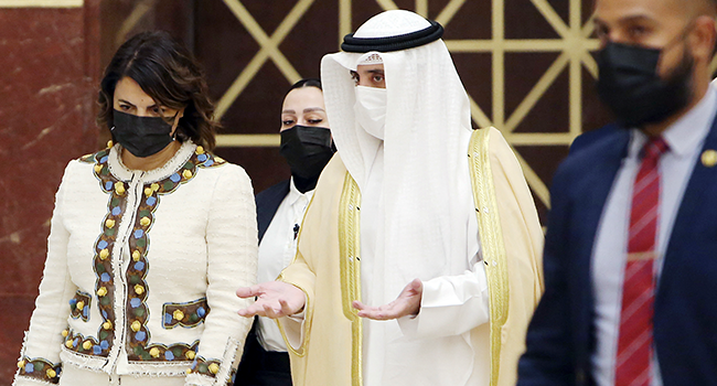 Libyan Foreign Minister Najla al-Mangoush (L) and her Kuwaiti counterpart Ahmad Nasser Mohammad al-Sabah arrive for a joint press conference in Kuwait City on October 3, 2021. YASSER AL-ZAYYAT / AFP